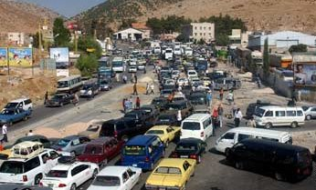 Vehicles clog the Masnaa border between Lebanon and Syria on the outskirts of Lebanon's Bekaa Valley