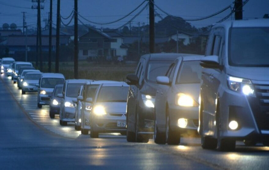 Vehicles make a line as they flee tsunami warning in Iwaki