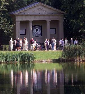 Visitors pay their respects at Althorp, Northamptonshire, Diana's resting place.