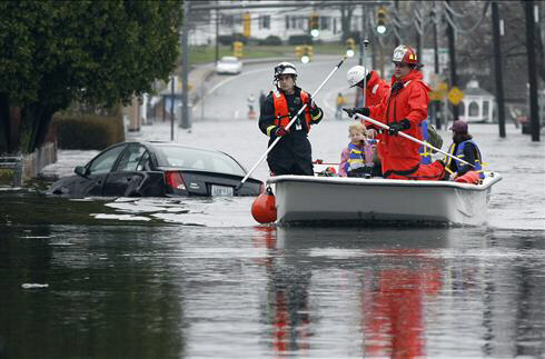 West Warwick, R.I., firefighters evacuate residents who live near the Pawtuxet River
