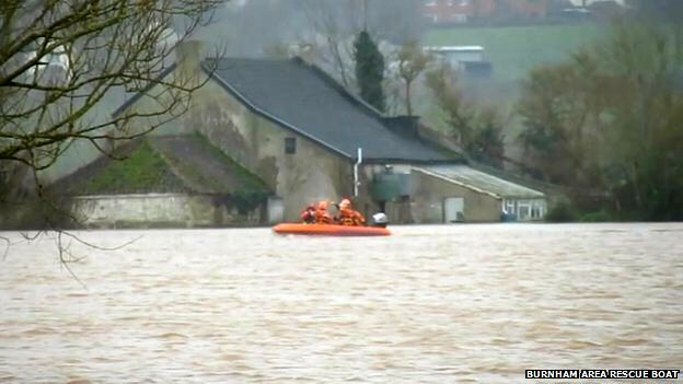 Woman rescued after 13 days surrounded by floodwater in Somerset