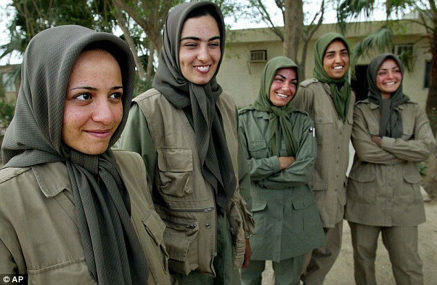 Resistance: Women fighters of the Mujahedin Khalq stand in their main base at Camp Ashraf