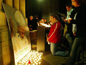 Poles kneel and pray Saturday at the Church of St. Mary in Karol Wojtyla's hometown of Wadowice.