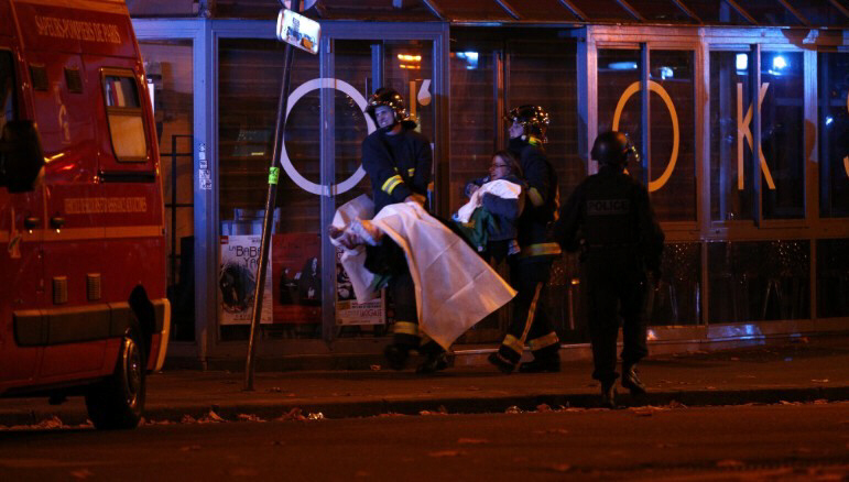 Wounded people are evacuated outside the Bataclan concert hall