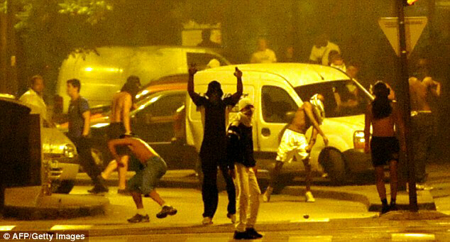 Youths launch missile at police during the height of the rioting in Villeneuve